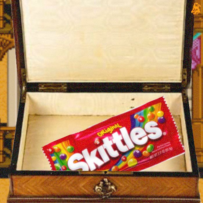 Skittles wrapper in a jewelry box